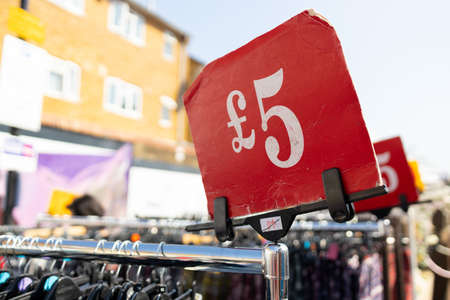 5 sterling pounds red price sign on a street flea market in London