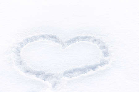 Heart drawn on the snow. Winter landscape. Soft focus