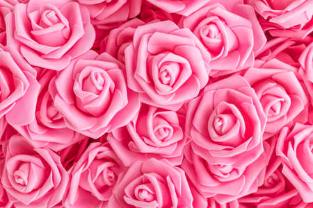 background of pink flowers. Artificial pink roses, foamiran roses. fake flowers. soft focus
