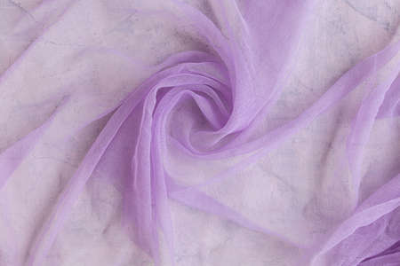 Texture of chiffon fabric in purple or lilac color for backgrounds Фото со стока