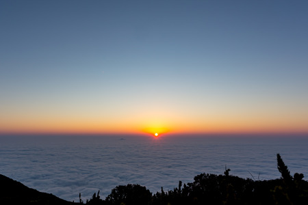 Sunrise in the cloudy sky Observed from a high place, above the clouds