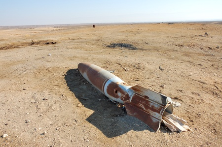 Rusty aircraft bomb on the ground.