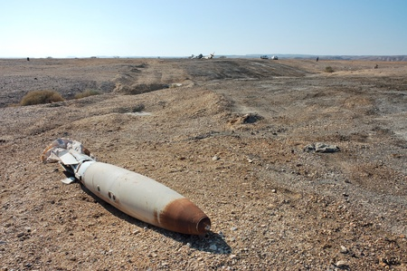 Rusty aircraft bomb on military polygon. Stock Photo