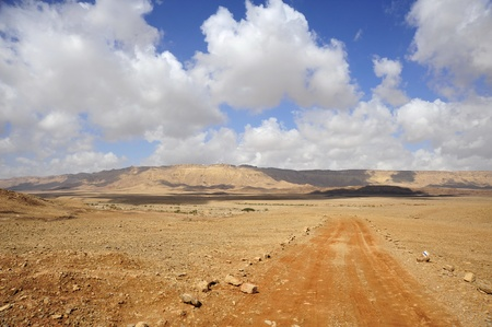 volcanic landscape: Hiking road in Ramon Crater, Negev desert in Israel. Stock Photo