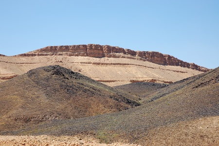 bazalt: Prism Canyon from bazalt stone in Ramon crater, Negev desert in Israel.