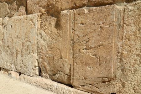 Huge ancient stone in Western Wall in old city of Jerusalem, Israel. Stock Photo
