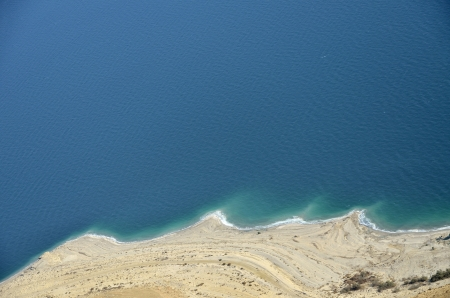 Aerial view of Dead Sea coast from Judea desert mountains, Israel. photo