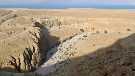 judea: Judea desert wadi landscape and Dead Sea on the background. Stock Photo