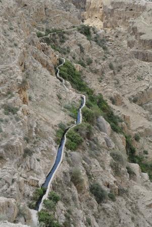 conduit: Ancient water conduit in Qelt gorge in Judea desert, Israel