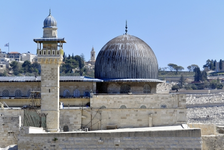 Al-Aqsa dome and minaret in Old City of Jerusalem  photo