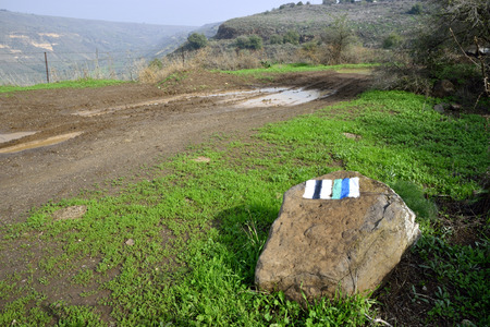 heights: Colored milestone on tourist trail on Golan Heights, Israel. Stock Photo