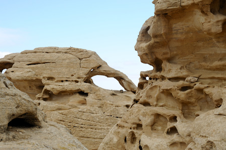rock arch: Rock arch and ancient sandstone formations in Jordan desert.