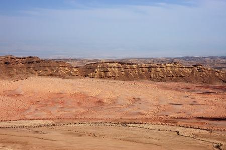Barren red landscape in Negev desert mountains, Israel