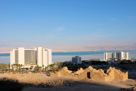 Modern hotels and ancient ruins at Dead Sea coast.