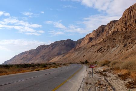 Empty highway leading to Dead Sea in Judea Desert.