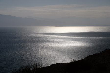 Light and shade on Dead Sea surface in Israel.
