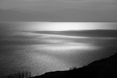 Light and shade on Dead Sea surface in black and white. Stock Photo