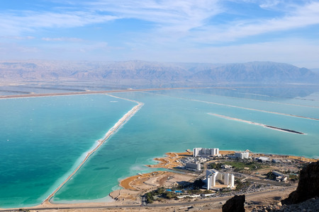 Aerial view on Dead Sea resort hotels and Jordan mountains.