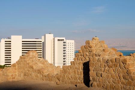 Modern hotel and ancient ruins at Dead Sea coast, Israel.