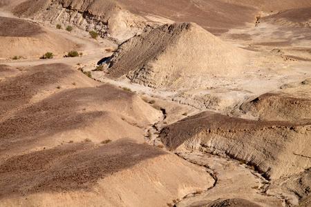 Dry winding riverbed near Dead Sea in Judea Desert.