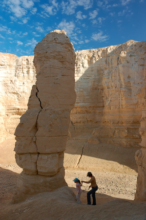Mother with little girl in white sandstone rock canyon, Negev desert in Israel.