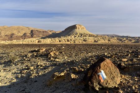 Milestone of Israel National Trail in Negev Desert.