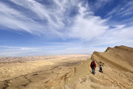 Mountain trekking on Big Crater edge in Negev Desert, Israel.