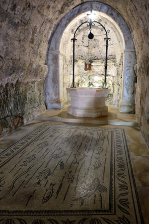 Ancient well in Grotto of Church of the Visitation, Ein Kerem near Jerusalem. Stock Photo