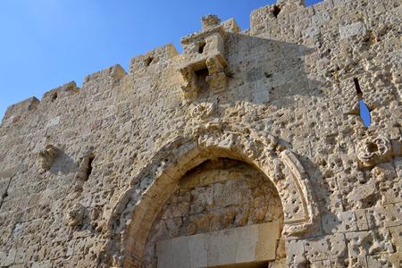 Damaged upper fragment of Zion Gate in Old City of Jerusalem, Israel.