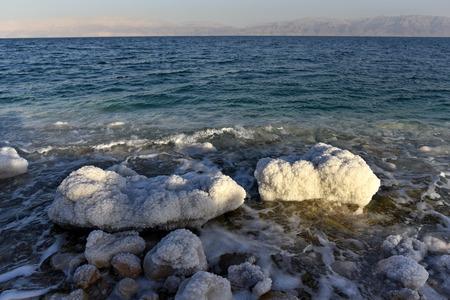 judea: Stones covered with salt on coast of Dead Sea, Israel.