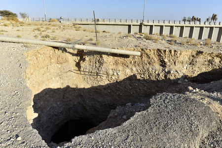Huge sinkhole in Ein Gedi National park after Dead Sea catastrophic drying, Israel