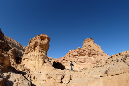 Scenic hiking in red canyon in Timna National park, Israel.