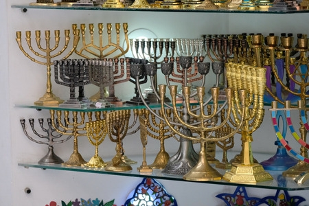 Hanukkah golden menorahs at showcase in souvenir store, Old City of Jerusalem.