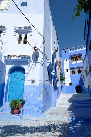 Blue painted cozy street in old residential district of Chefchaouen in Morocco.