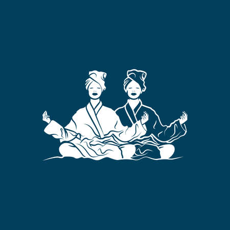 Two girls in lotus position meditate in bathrobe and take spa treatments