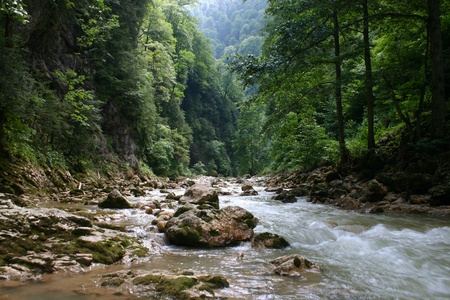 turbid: Small thresholds of the fast river among mountains