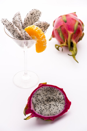 Fruit pulp of the strawberry pear  White pulp of the strawberry pear covered in a vibrant violet skin  Wedges are easily assorted in a glass  A piece of mandarine is added to complement the purple color of its rind