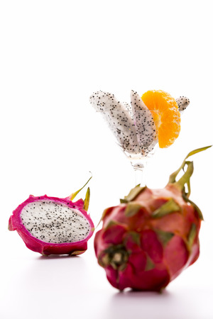 dragonfruit: White fruit pulp and vibrant purple skin  The slightly leafy rind and vibrant purple color of the pitaya is giving this exotic fruit its dragon-like appearance, from which the name dragonfruit is derived