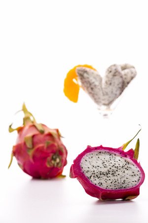 Dragonfruit for dessert  The dragonfruit has a blazing white pulp, a vibrant violet, leathery skin and a mild aroma reminiscent of the kiwi fruit  Serve chilled as a refreshing desert  Imagens