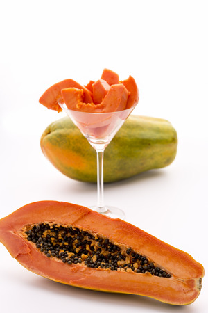 globose fruits: The large-fruited Papaya   A papaya fruit in longitudinal section, its fruit pulp assorted in a cocktail glass and a whole fruit