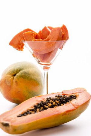 papaw: A Caribbean dream - the Papaw fruit   Peeled pieces of the Papaw fruit presented in a long-stemmed glass