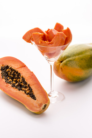 peppery: Tangerine pulp and peppery seeds - the Papaya   Wedges of papaya fruit pulp assorted in a long-stemmed glass