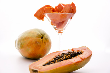papaw: Papaw fruit - full of provitamin A carotenoids   Blazing tangerine slices of the papaw fruit assorted in a long-stemmed glass  A papaw halved along its longitudinal axis in the foreground and a whole fruit in the back