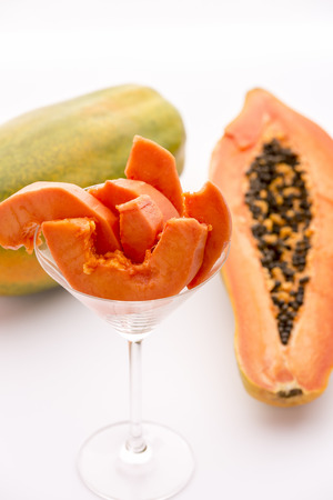 papaw: A succulent juicy snack - the Pawpaw fruit   A long-stemmed cocktail glass filled with tangerine papaya slices  The papaya is also called papaw or pawpaw