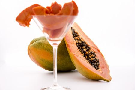 globose fruits: Globose body and tangerine pulp - Papaya   Blazing tangerine fruit pulp of the papaya revealed by a longitudinal cut through this tropical fruit