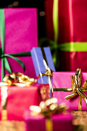 name day: Six presents prepared for any gift-giving occasion  Focus is on the golden bow knot around the small magenta box on the right