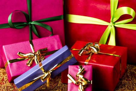 name day: Four small and two larger presents with bow knots  Vibrant, plain colors  Background for many gift-giving occasions