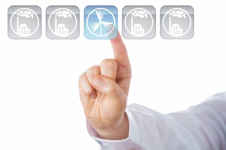 turnaround: Index finger selecting a button with a wind turbine icon. Lighting up in blue, this key is in the center of a line-up of five. The other four grey icons show smoking factories. Cut out on white.