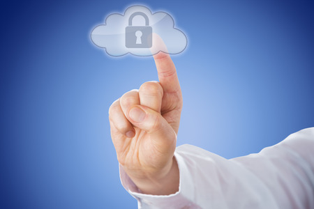 converged: Raised male right index finger is pushing a transparent cloud button from behind. The highlighted cloud computing key does show a padlock icon. Blue background with even gradient. Close-up. Stock Photo