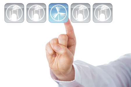 nuclear energy: Close up of a male index finger choosing a blue wind power icon over nuclear energy icons in a row of five push buttons. Cut out isolated over white background. Rasterized vector illustration artwork. Stock Photo
